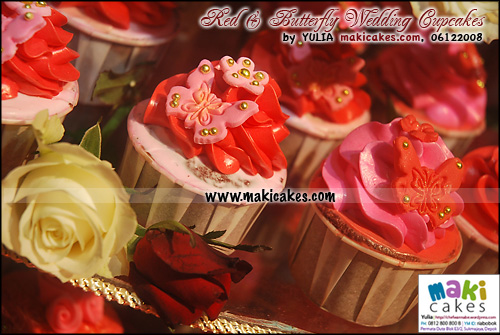 red-butterfly-wedding-cupcakes_red-swirl-maki-cakes