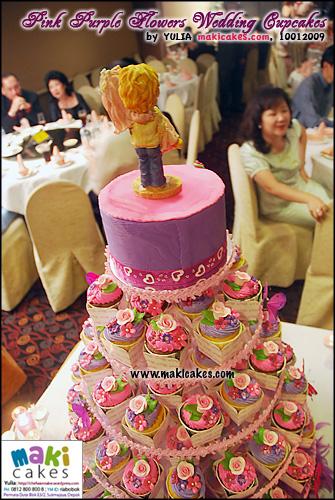 pink-purple-flowers-wedding-cupcakes_-maki-cakes