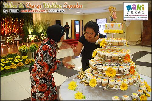 Yellow & Orange Umbrella Wedding Cupcakes__ - Maki Cakes